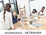 young business team discussing... | Shutterstock . vector #687846484