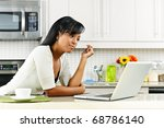 thoughtful black woman using... | Shutterstock . vector #68786140