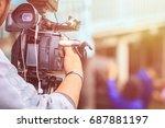 cameraman using black... | Shutterstock . vector #687881197