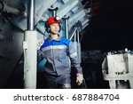 miner man stands in a helmet in ... | Shutterstock . vector #687884704