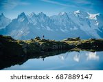 athlete trail running at a lake ... | Shutterstock . vector #687889147