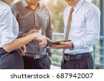 two employees stand talking and ... | Shutterstock . vector #687942007