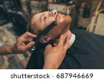 male barber combing customers... | Shutterstock . vector #687946669