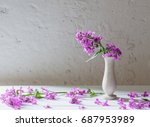 Small photo of Hesperis matronali flowers in vase on white background