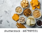 salty beer snacks in whit bowls | Shutterstock . vector #687989551