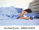 young woman hand hold remote... | Shutterstock . vector #688010305