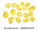 Small photo of Top view close up photo image of scattered ridge potato chips isolate on white background, fatten and unhealthy food concept