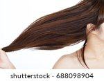 woman with beautiful long hair | Shutterstock . vector #688098904