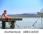 boy in a wooden pier on the... | Shutterstock . vector #688116565