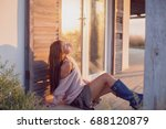 woman in sunrise rays of the... | Shutterstock . vector #688120879