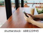 hand of woman use smart phone... | Shutterstock . vector #688123945