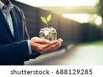 businessman cover growing plant ... | Shutterstock . vector #688129285
