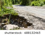The Road Has A Large Gully...