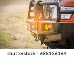 Pickup truck a font of 4 WD adventure off road font view has Bumper, turn signal, spotlight, towing, hook, headlights.