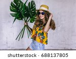 teen girl with tropical leaves... | Shutterstock . vector #688137805
