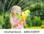 adorable little girl playing... | Shutterstock . vector #688143859