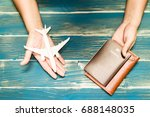 woman hands hold a passport and ... | Shutterstock . vector #688148035