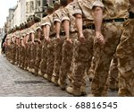 A column of British soldiers on a homecoming march.