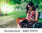 beautiful woman writing into... | Shutterstock . vector #688170955
