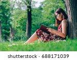 beautiful young brunette... | Shutterstock . vector #688171039