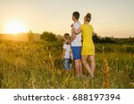 happy family standing outdoors... | Shutterstock . vector #688197394