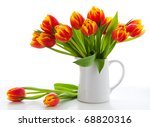 Red Tulips In A Jug On White...