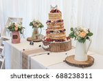 naked wedding cake decorated... | Shutterstock . vector #688238311