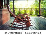 wooden rocking chair on front... | Shutterstock . vector #688245415