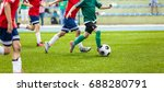 soccer player action on stadium.... | Shutterstock . vector #688280791
