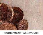Wicker Ware On A Wooden...