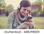 happy woman watching videos in... | Shutterstock . vector #688298005