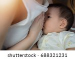 asia baby is happy at breast... | Shutterstock . vector #688321231