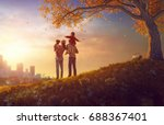happy family at sunset. father  ... | Shutterstock . vector #688367401