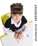 schoolgirl at the lesson | Shutterstock . vector #688380469