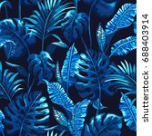 tropical palm leaves background.... | Shutterstock .eps vector #688403914
