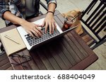 freelancer working on laptop in ... | Shutterstock . vector #688404049
