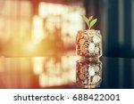 plant growing out of coins with ... | Shutterstock . vector #688422001