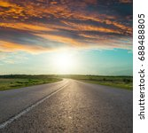 asphalt road to horizon in red... | Shutterstock . vector #688488805