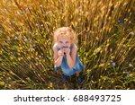 little girl in a field ...   Shutterstock . vector #688493725