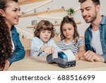 beautiful young family paying... | Shutterstock . vector #688516699