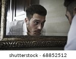 man takes a look at himself in... | Shutterstock . vector #68852512