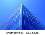 Office building details reflecting, blue sky in windows - stock photo