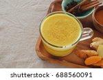 turmeric latte  golden milk ... | Shutterstock . vector #688560091