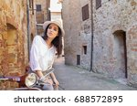 italian woman on a scooter on... | Shutterstock . vector #688572895