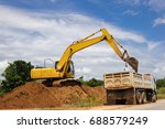 backhoe is loaders are sand...
