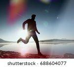 running man on beach. sportsman ... | Shutterstock . vector #688604077