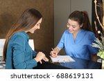 nurse or dentist attending a... | Shutterstock . vector #688619131
