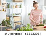 woman preparing healthy meal in ... | Shutterstock . vector #688633084