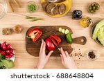 partial view of woman cutting... | Shutterstock . vector #688648804