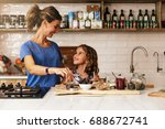 little girl cooking with her... | Shutterstock . vector #688672741